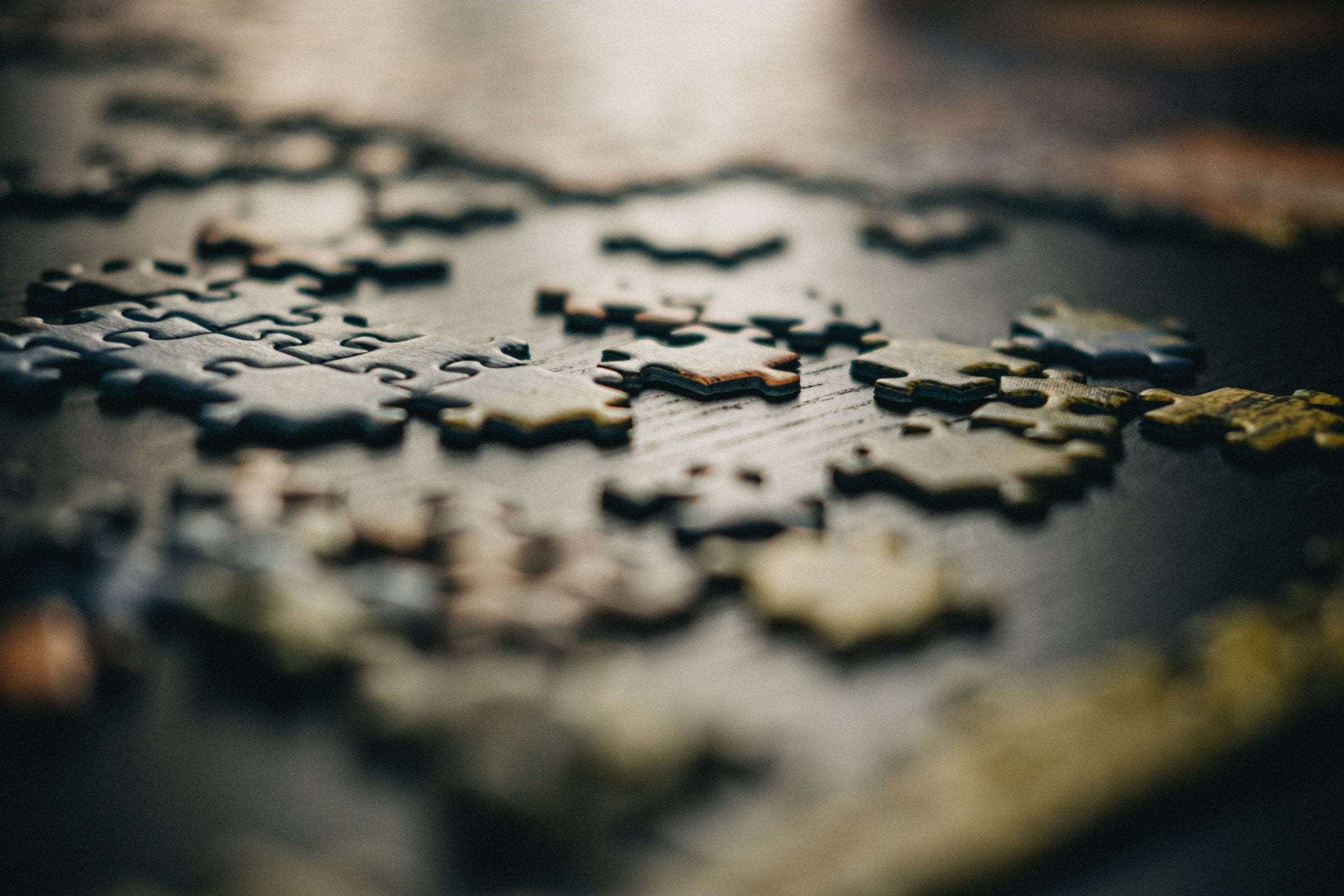 An uncompleted jigsaw puzzle on a table
