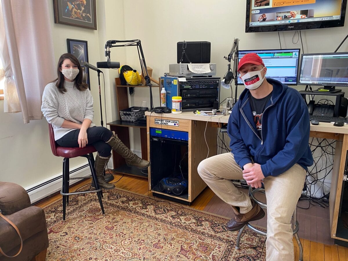 Vervology's Sarah and Tunes 92.5's Quince sitting in a recording room