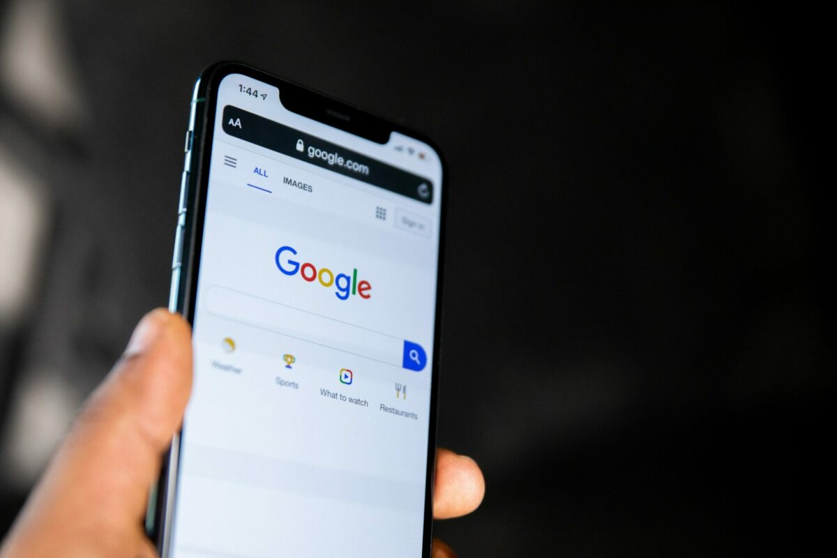 Google on a mobile phone, demonstrating the importance of local SEO