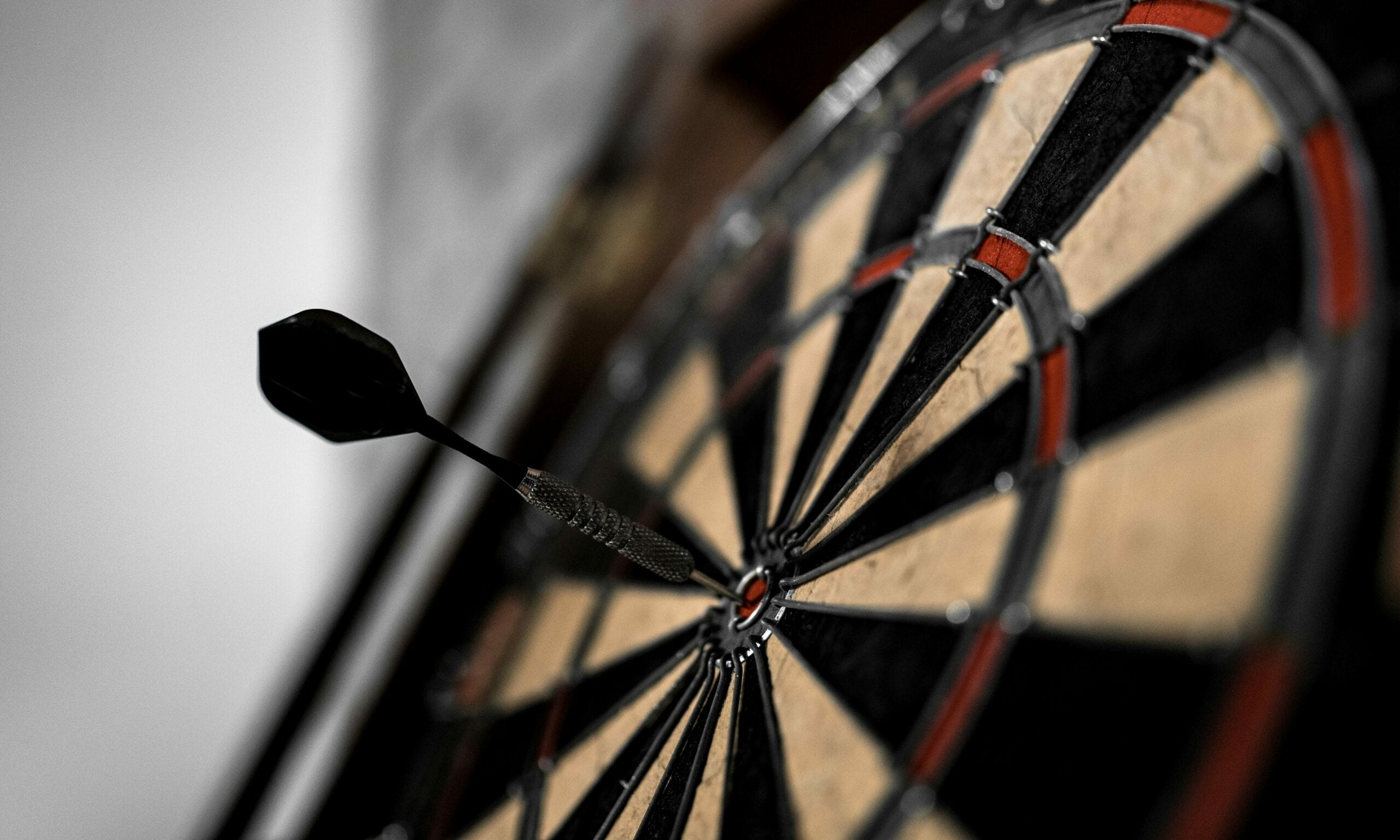 A dartboard with a dart in the center to signify meeting a goal