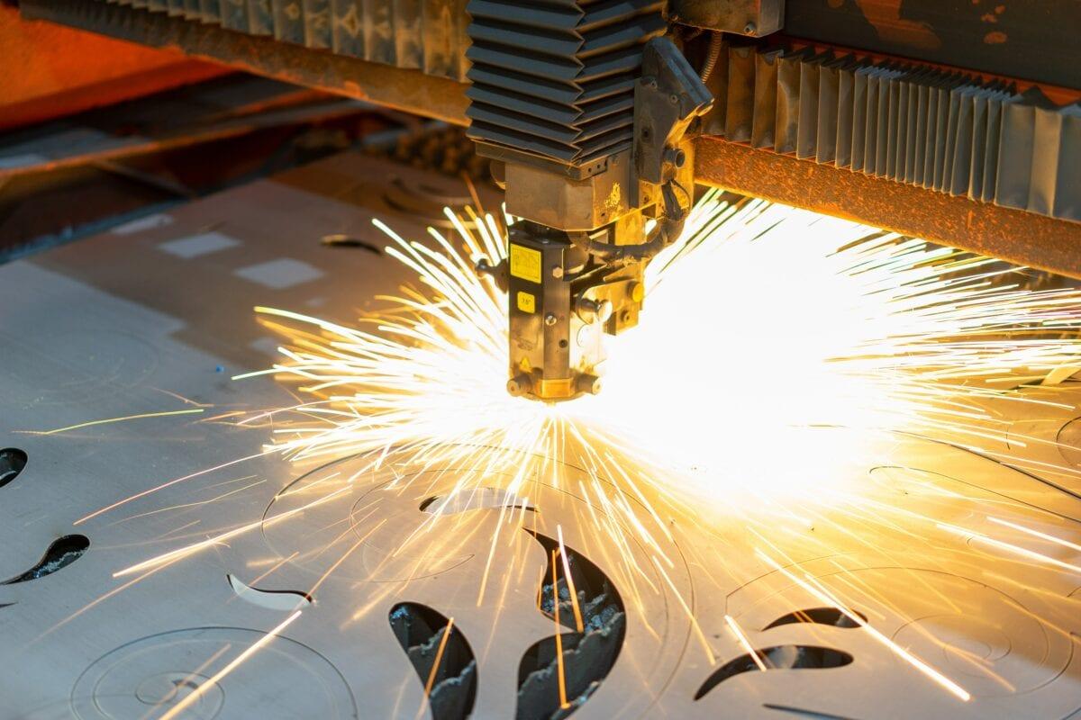 An industrial tool burning metal outlines