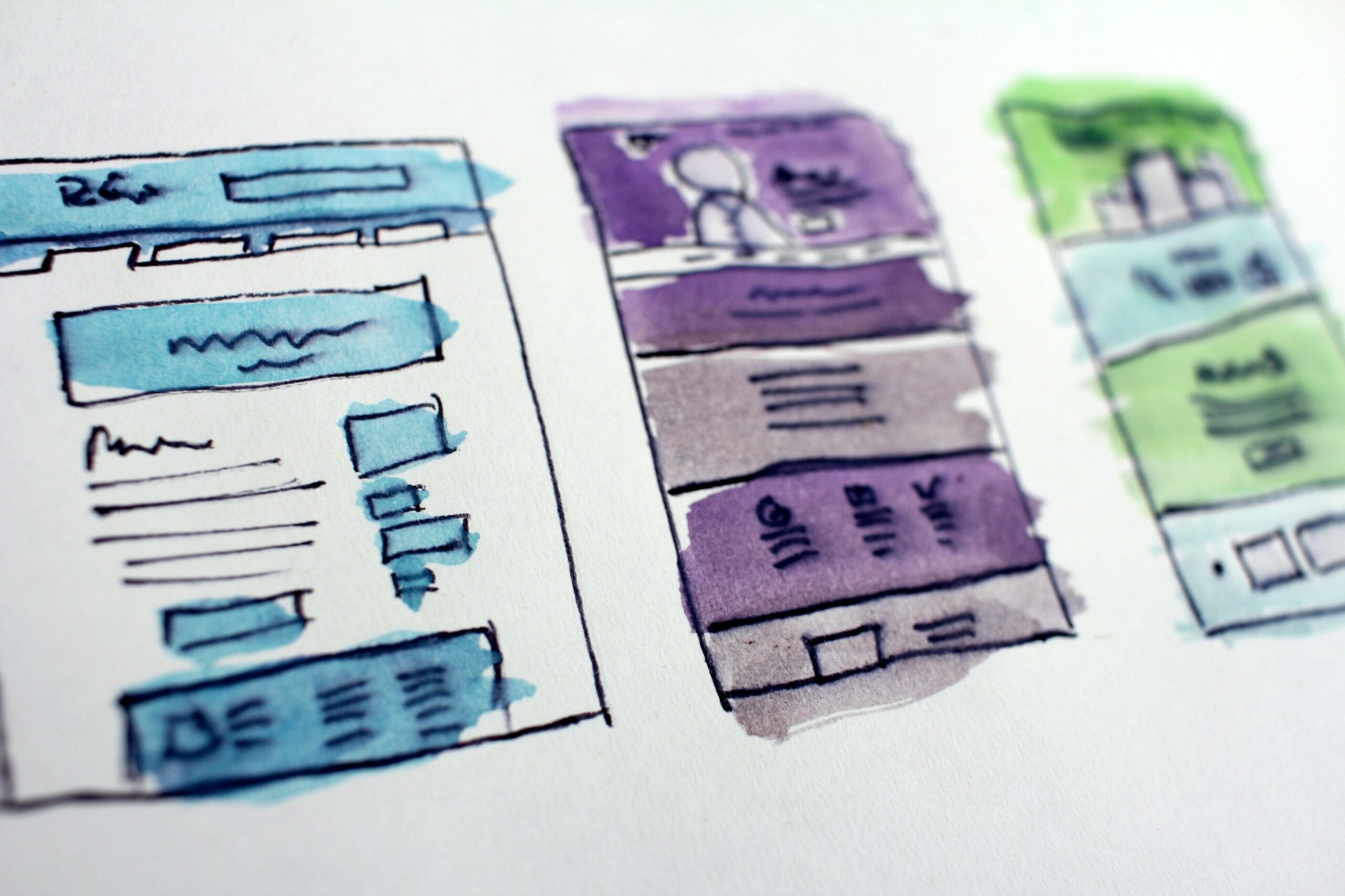 Drawings of website layouts on paper.