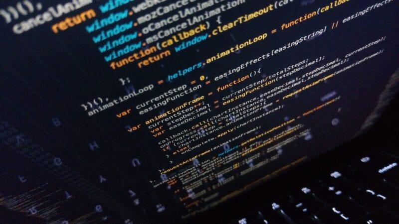 Code on a dark screen