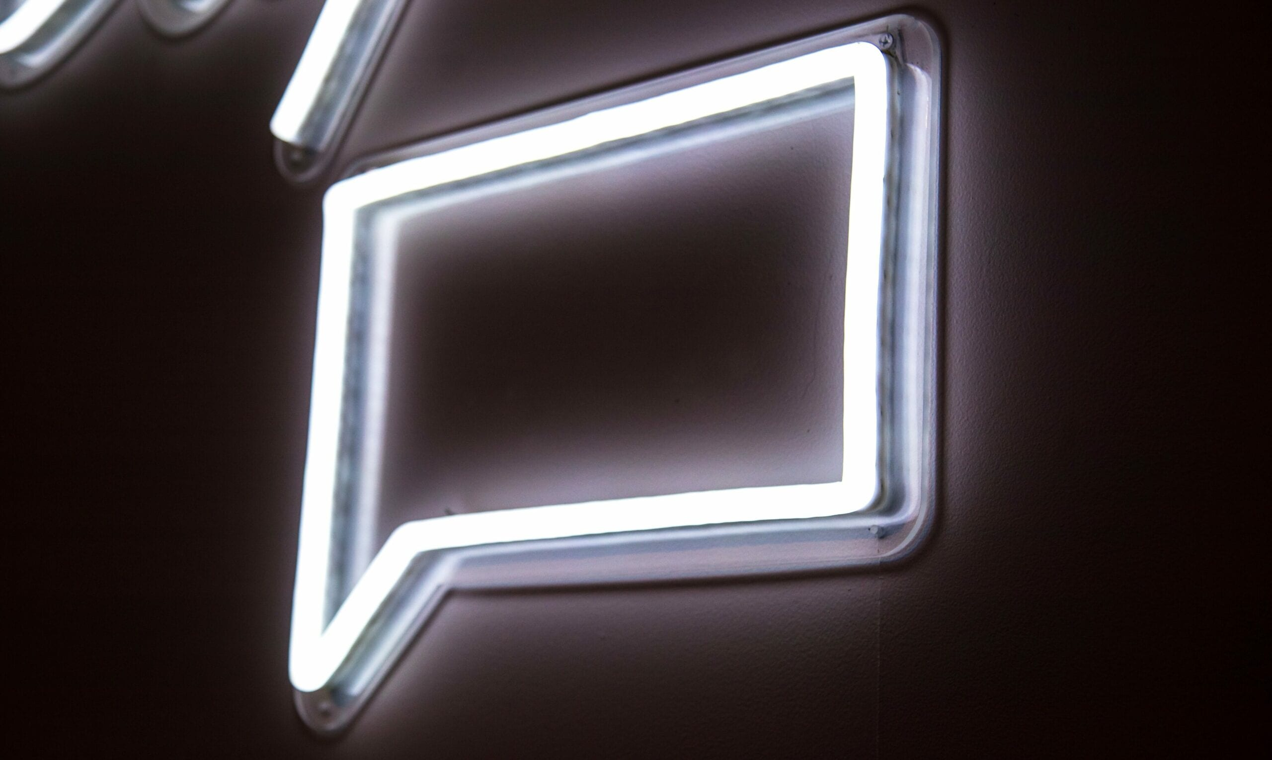 A fluorescent sign of a text bubble