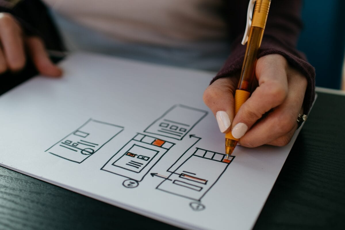 Someone drawing out a site plan on a piece of paper