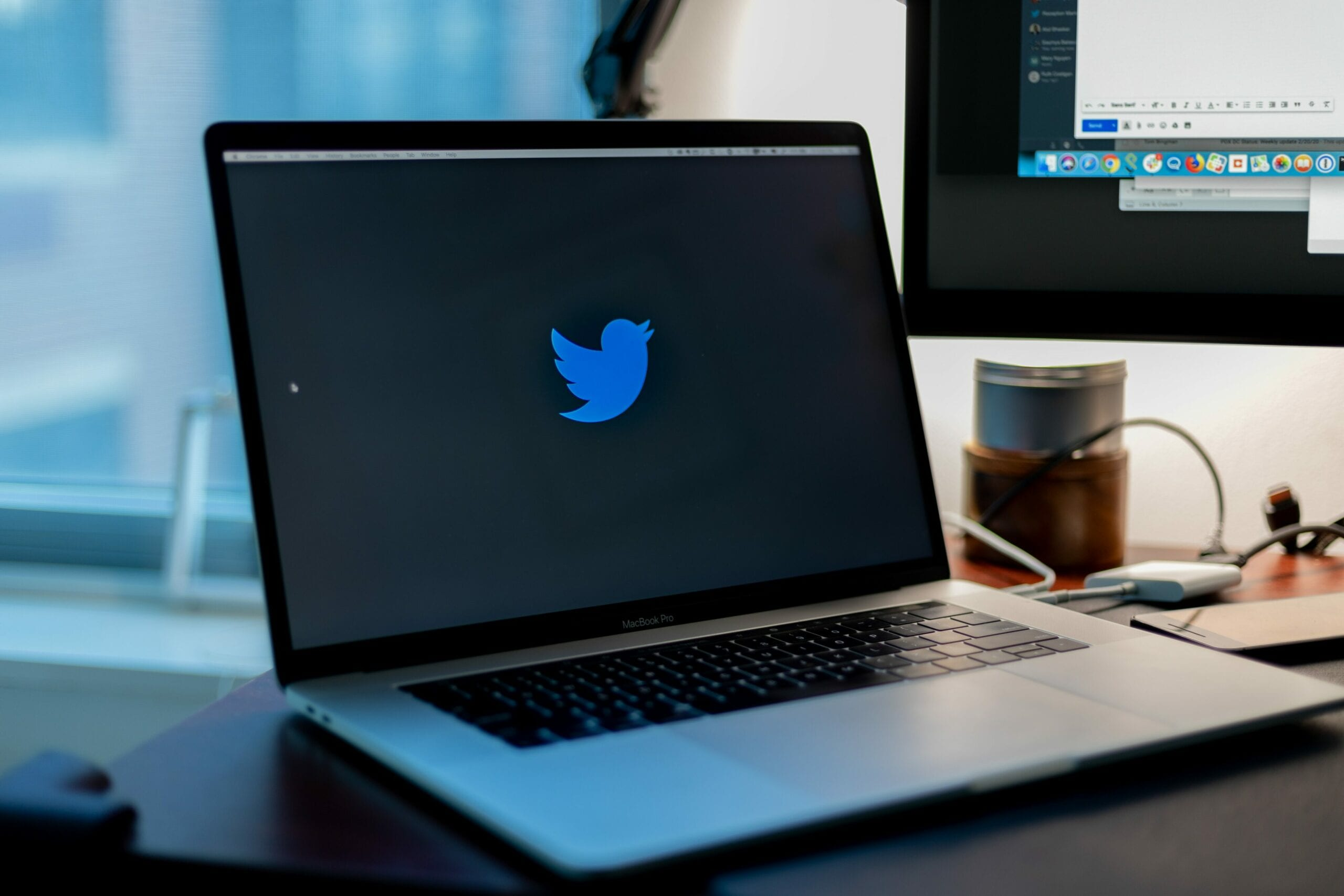 A laptop with the Twitter logo on the screen