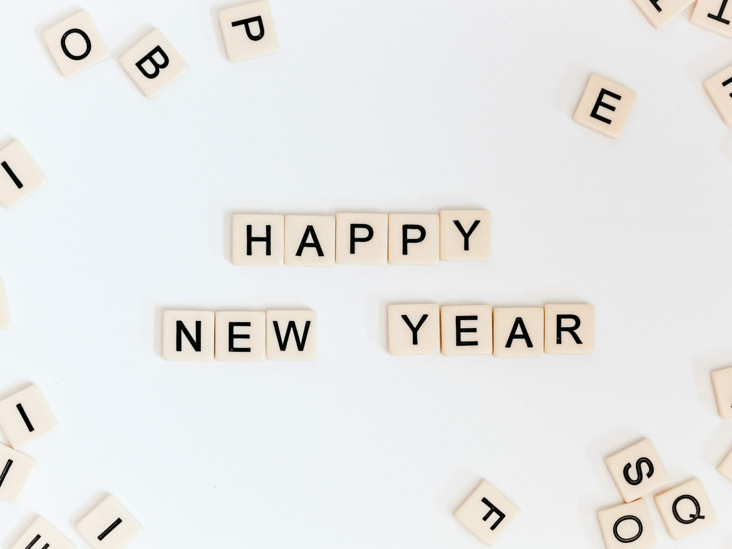 "Scrabble tiles saying ""Happy New Year"""